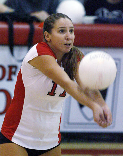 Flintridge Sacred Heart libero Colleen Degnan bumps the ball off the serve  against La Salle in a nonleague girls volleyball game at FSHA in La Canada Flintridge on Tuesday, September 25, 2012. La Salle swept the match 3-0.