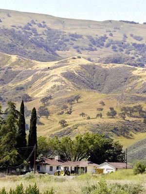 A farmhouse sits near the site of the proposed Newhall Ranch housing development. An L.A. County Superior Court judge has backed alleged flaws in the massive project's environmental review.