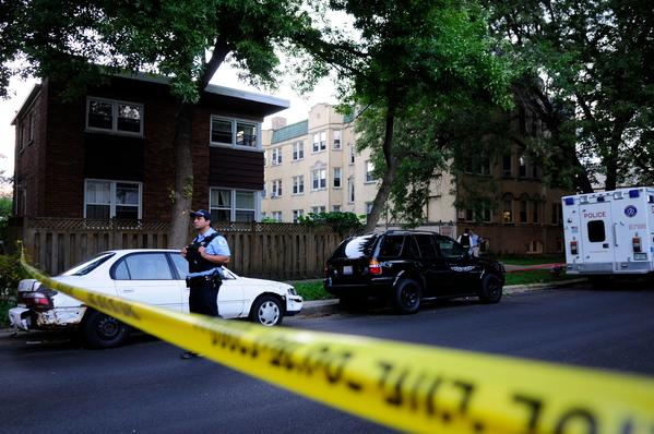 Chicago police investigate a scene where two people were found dead on the 6400 block of North Sacramento Avenue.