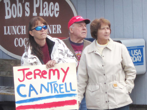 Debbie Hall and Millard and Sue Jewell of Alanson eagerly wait for Sgt. Cantrell's arrival.