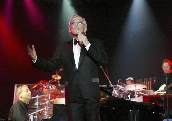 Andy Williams performs in 2004 in Bangkok, Thailand.