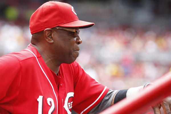 "Reds Manager Dusty Baker, who was hospitalized in Chicago last week, said he's ""feeling much better,"" but he won't return to the dugout for at least another week."