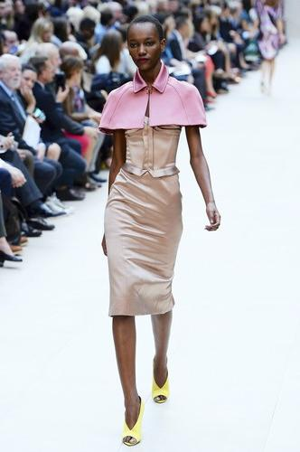 I'm loving the Burberry Prorsum Spring/Summer collection that was unveiled recently at London Fashion Week. Christopher Bailey, chief creative officer for the brand, focused on corsets, capes and metallics for this fashion-forward collection. The fabrics, which included everything from feathers and lace to metallic leather and silk, were very much in line with the major designers this season. The variety of tones - white, nude, tan, bronze, copper, pink, lipstick red, fuchsia, green and an array of blue - mean there will be plenty of colorful options to chose from come spring. My favorite accessory from the collection: satin and metallic python wedges. These are sure to attract serious fashionistas. Find Burberry's current fall collection at Burberry.com or at the Burberry store in Towson Town Center.