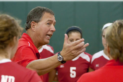 Parkland girls varsity volleyball head coach Mike Krause talks with his team during a timeout in their match against Emmaus at Emmaus High School on Tuesday night. Parkland won the match in four games 24-26, 25-15, 26-24 and the final 25-14.