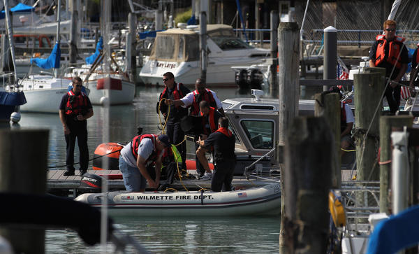 Divers from Wilmette and Northbrook search for Harsha Maddula at Wilmette Harbor near Gilson Park in Wilmette, Ill.