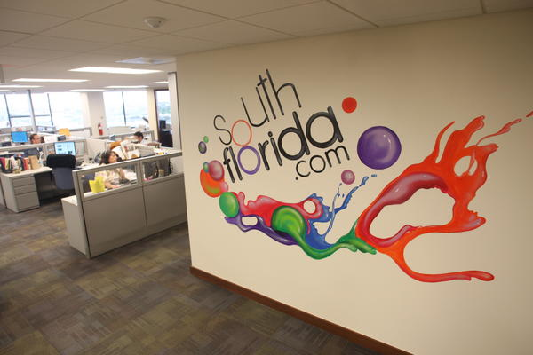 "The SouthFlorida.com mural in the Sun Sentinel newsroom painted by <a href=""https://www.facebook.com/marvel.imapstudios"">Virginia Marvel</a>"