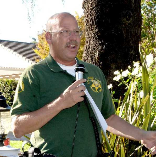 Crescenta Valley Sheriffs Deputy Eric Matejka offered Oakwood Avenue residents tips on how to keep their neighborhood safe from burglars during the annual Oakwood block party on Sunday, Sept. 23.