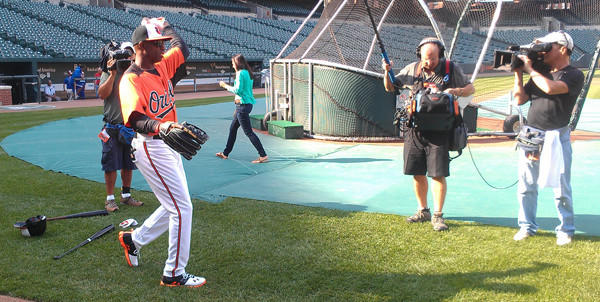 Deion Sanders throws during warmups before the Orioles' game Wednesday night. Sanders, who played for Buck Showalter in the New York Yankees organization, was visiting the team and also took batting practice. He's in town with the NFL Network for Thursday's Ravens game against the Browns.