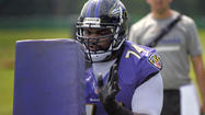 Michael Oher strolled into the Ravens' locker room, looked at the sheet of paper taped to one wall and let loose a string of epithets that would make an entire convent faint.