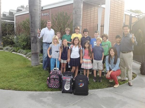 CFC founders Gary Allhusen, Jennifer and Carlos Aguilar with students from their school.