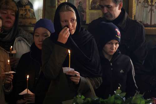 Mourners attend funeral services in Moscow for five teenagers killed by a suspected drunk driver.