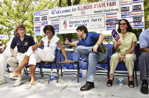 Michelle Obama jokes with Illinois Gov. Rod Blagojevich during the Governor's Day Rally at the Illinois State Fair. Barack Obama was a state senator at the time, running for U.S. Senate. At right is Illinois Attorney General Lisa Madigan.