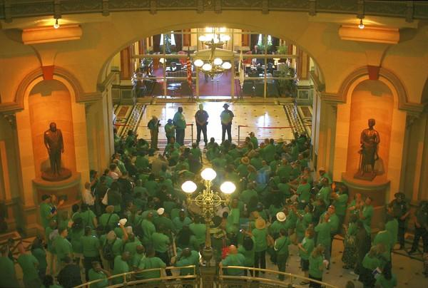 AFSCME members rally outside the office of Gov. Pat Quinn at the Capitol in Springfield in May.