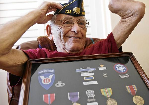 Harold Tor, a World War II veteran shows off his medals that he received after more than a half century at his home in Huntington Beach in June.