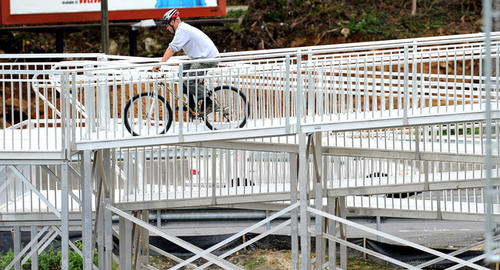 A bicyclist rides over the new pedestrian bridge over rt. 22 at rt. 145 Wednesday as renovations to the busy intersection continue.