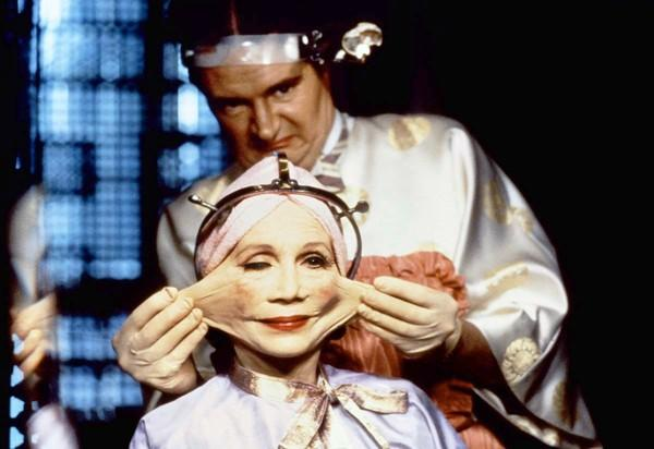 "Jim Broadbent and Katherine Helmond stretch a little in 1985's ""Brazil."""