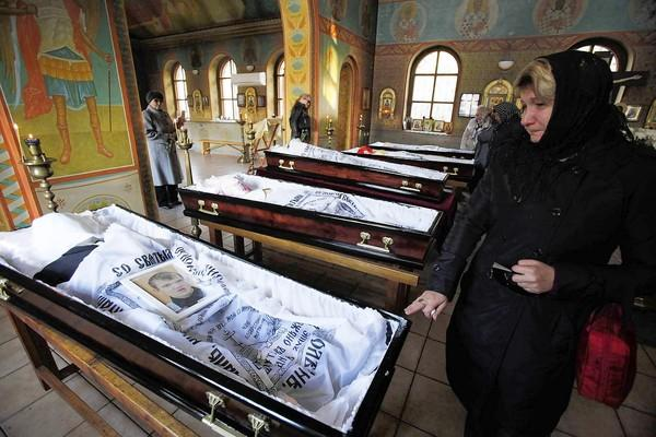 The caskets of five teenagers killed by a suspected drunk driver are displayed at an Orthodox temple in Moscow.