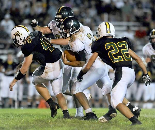 Central Catholic #2 Colin McDermott carries the ball past emmaus #44 Mike Weldon.