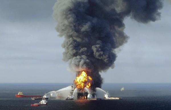 Fire crews respond at the scene of the 2010 Deepwater Horizon oil rig disaster in the Gulf of Mexico. House Republicans grilled William Reilly, a former EPA administrator under GOP President George H.W. Bush, when he testified about the need for better regulation of offshore drilling.