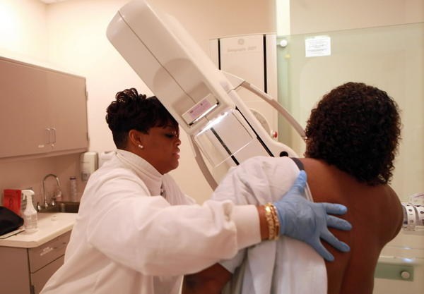A mammographer at University of Chicago Hospitals in Chicago gives an annual mammogram to a patient