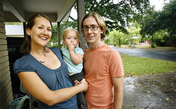 Sarah Lisle stands with her daughter Lily Lisle and husband Matt Lisle