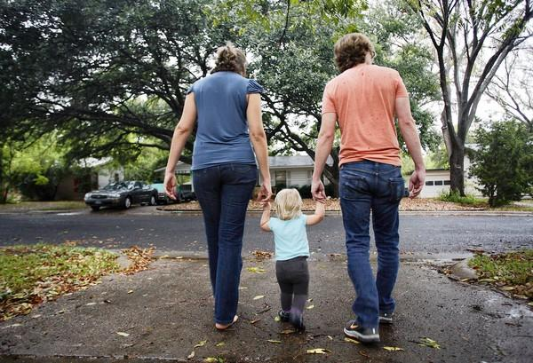 Sarah Lisle stands with her daughter Lily Lisle and husband Matt Lisle. Lisle decided to undergo IVF and freeze embryos which later on her sister in law, Lisa Cover became the surrogate mother. The Lisle family live in Austin, Texas on September 13, 2012.