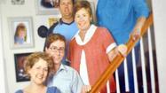 A family photo showing Sarah Lisle and Matt Lisle holding newborn Lily Lisle