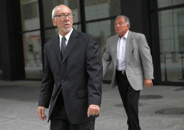 "Rudy ""The Chin"" Fratto, left, leaves the Dirksen U.S. Courthouse after being sentenced Wednesday to one year in prison for a contract-rigging scheme at McCormick Place."