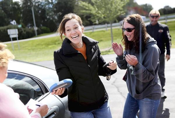 Alyssa Duvel, left, of Buffalo Grove and teammate Laura Sachs of Chicago celebrate winning a challenge in the first leg of the Amazing Race 3 Road Rallye at Juniper Park in Hoffman Estates Sunday.