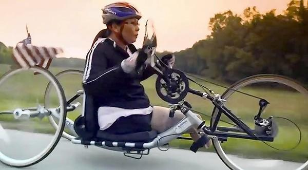 8th Congressional District candidate Tammy Duckworth rides a bicycle in her new video ad.
