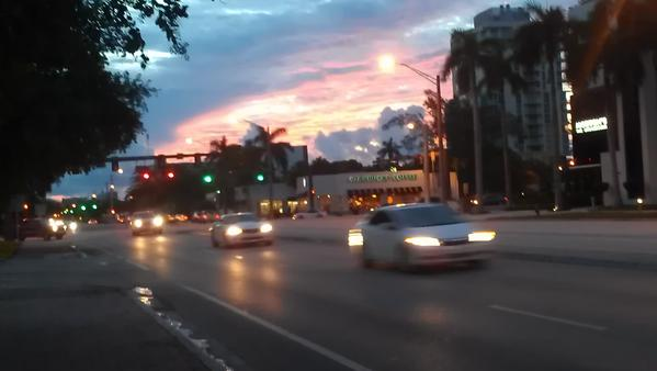 Dawn breaks on Broward Boulevard near Federal Highway in downtown Fort Lauderdale on Thursday, Sept. 27, 2012.