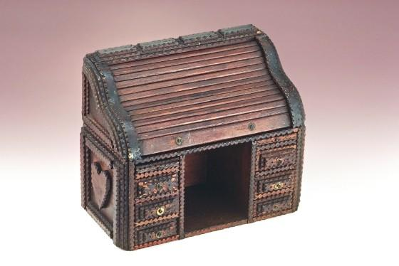 "This miniature roll-top desk, probably made in Pennsylvania about 1900-1925 is one of the works on view at the Abby Aldrich Rockefeller Folk Art Museum in ""Tramp Art."""
