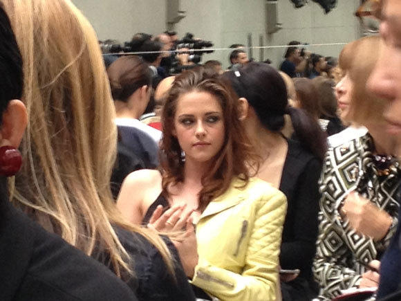 Kristen Stewart sits next to Anna Wintour at the Balenciaga spring-summer 2013 runway presentation during Paris Fashion Week.