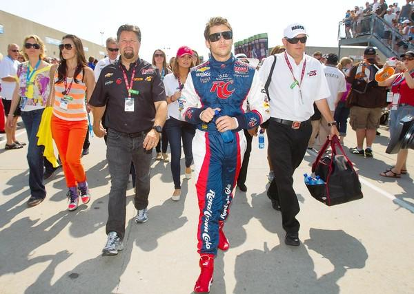 Michael Andretti (black shirt) and IZOD IndyCar series driver Marco Andretti walk to pit road before the Indy 500 at Indianapolis Motor Speedway on May 27, 2012.
