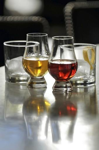 Max Fish offers a Somerset Manhattan, left, featuring a white corn whiskey, Dolin dry vermouth and aged for six months in new American oak; and a barrel-aged Negroni, Hendricks Gin, Carpano Antica sweet vermouth, Campari, blended in-house and aged over two months in toasted oak.