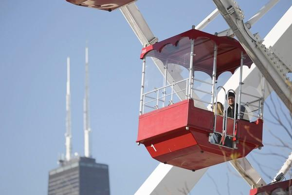 Visitors to Navy Pier ride the Ferris Wheel.