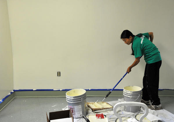 Air Products employee Shiying Zheng, of Center Valley volunteers her time painting areas of New Bethany Ministries in Bethlehem during the United Way of the Greater Lehigh Valley's 20th annual Day of Caring. More than 600 employees from 42 area businesses volunteer their time, valued at $91,518, to 43 area non-profits.
