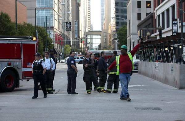 Chicago Fire Department and Chicago Police remain on the scene where a gas line was hit today at a construction site at 522 N. Clark St. in Chicago.