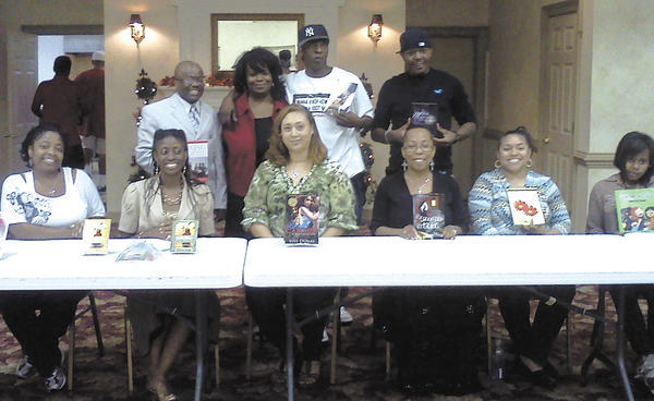"""The inaugural Urban Book Festival was held Saturday at Bridge of Life on South Potomac Street in Hagerstown. Ladetra Robinson, back row, hosted the book fair along with her Sister in Spirit Book Club. The authors on hand were, front row, from left, KaNikki Jakarta, Melanie Bonita, Vivi Dumas, C. NaTasha Richburg, Deanna Marsha Saunders and Aliyah Saunders (14-year-old author). Back row, Leroy McKenzie, Robinson, Adrian """"Ox"""" Mendez and DeVaughn Lilly."""