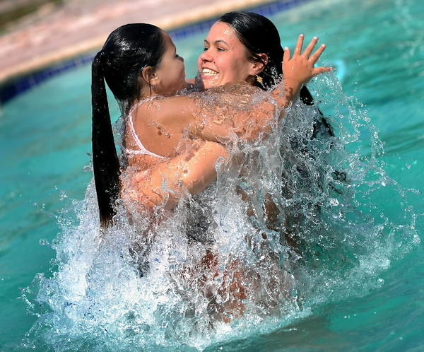Mother and daughter frolic in a Pompano Beach swimming pool.