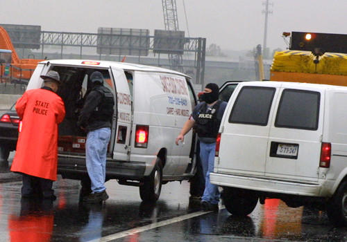 Fairfax County, Va. police check a van on Interstate 395 in Springfield, Va., Friday, Oct. 11, 2002 as police searched for a sniper on the major interstate after a van was seen leaving the scene of a deadly shooting at a Virginia gas station Friday morning. It wasn't immediately clear if the shooting near Fredericksburg was linked to nine sniper attacks that have left seven people dead in the Washington area. (AP Photo/Adele Starr)