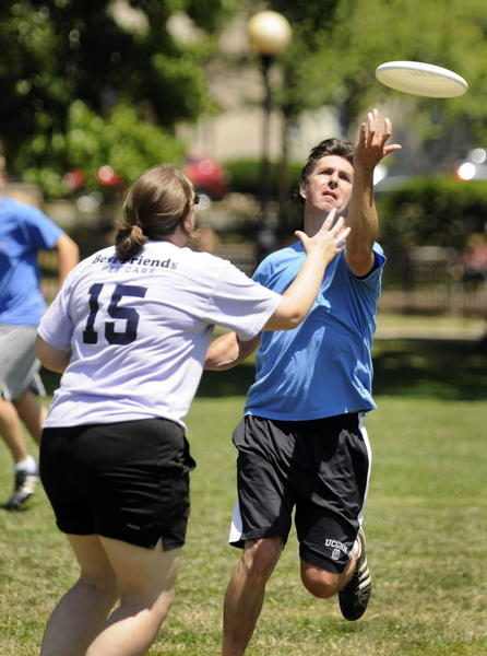 Rob Bell of West Hartford reaches for the Frisbee ahead of teammate Ellie Pelletier of Bristol during a game of Ultimate Frisbee in Bushnell Park in early July.