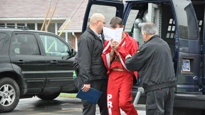 Dion Blair Wilt, a Johnstown man charged in two bank robberies, is led into District Judge John Barrons office by Cambria County Prison guards.