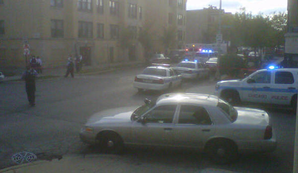 Police at the scene of shots fired by police in the 5600 block of West Washington Boulevard this afternoon.