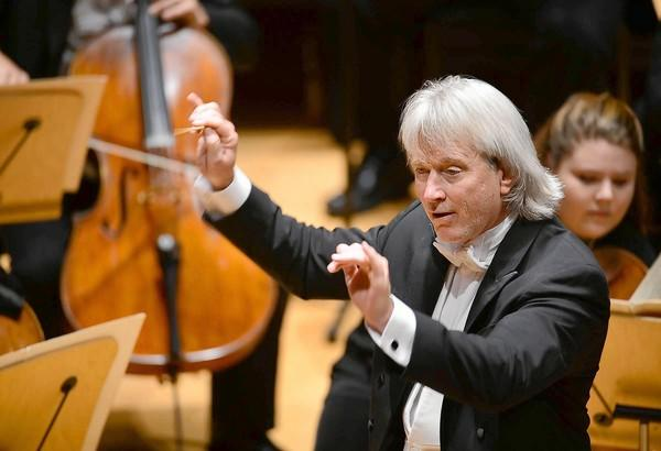 Carl St.Clair conducts the Pacific Symphony during opening night Sept. 20 at the Renee and Henry Segerstrom Concert Hall in Costa Mesa.