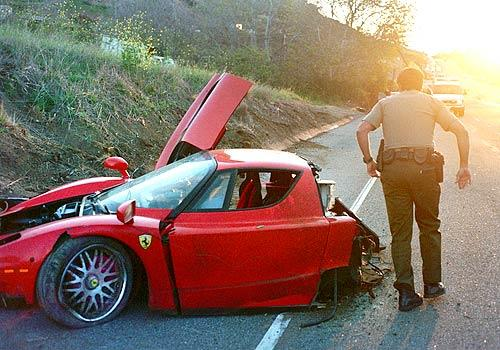 A deputy passes the wrecked Ferrari that crashed on Pacific Co