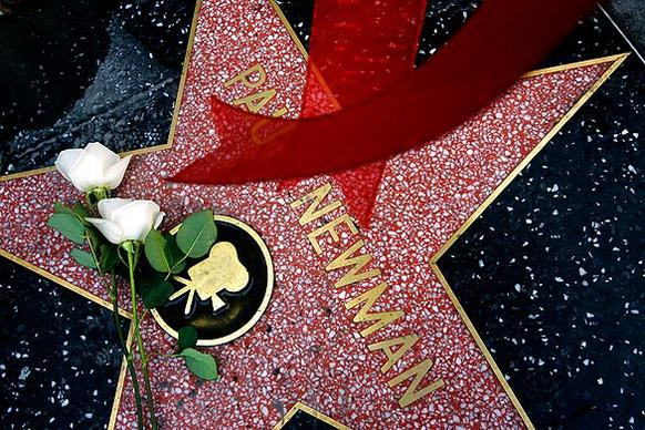 "Flowers were left on the Hollywood star of actor Paul Newman. The legenary star of  ""The Hustler,"" ""Cool Hand Luke"" and ""Butch Cassidy and the Sundance Kid"" died of lung cancer at his home in Connecticut."