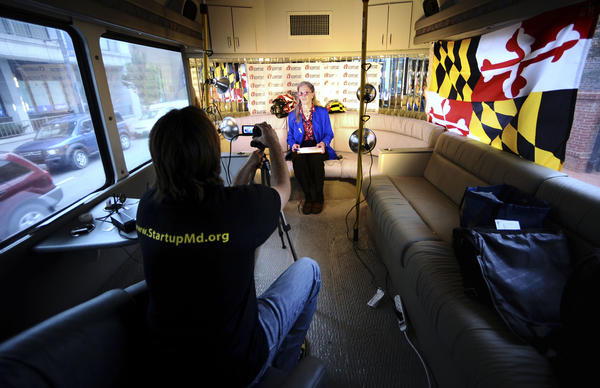 Michael Binko videos entrepreneur Rebecca Rush in the Pitch Across Maryland bus Thursday in downtown Hagerstown. Hagerstown was the tour's 23rd stop.