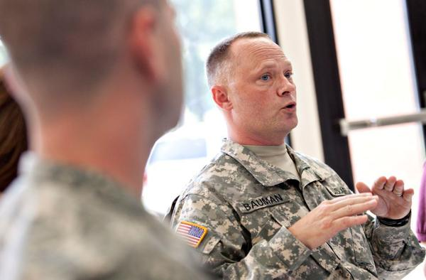 Chief Warrant Officer 4 Clifford W. Bauman, right, talks of his experience with PTSD during a round table discussion at Fort Eustis in Newport News on Thursday.