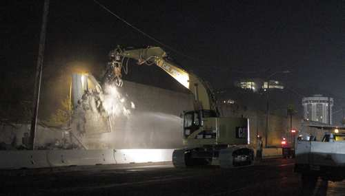 A sound wall is demolished on Sepulveda Boulevard, south of Sunset. For 2 1/2 years, residents of Westwood Hills have lived with the noise and shaking and lights from construction through the Sepulveda Pass. Much of the heaviest and loudest lifting is done at night, with the result that homeowners have had construction roar coming at them with the intensity of a diesel truck moving at 50 miles an hour 50 feet away. According to Caltrans, the noise of that diesel truck is equivalent to 86 decibels, the loudest level allowed at night under an agreement with homeowners.